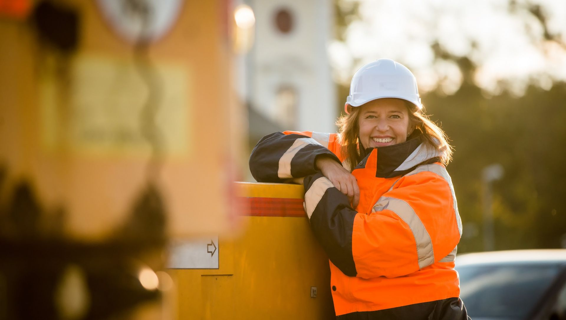 Construction lady poses for a photo